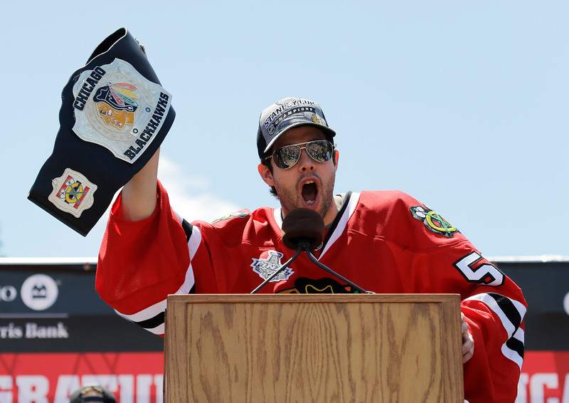. Chicago Blackhawks goalie Corey Crawford speaks to the thousands of fans gathered for a rally in Grant Park to honor the NHL Stanley Cup hockey champions Friday, June 28, 2013, in Chicago. (AP Photo/Nam Y. Huh)