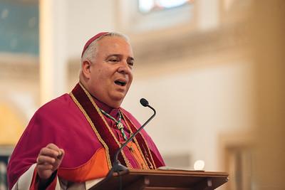 Archbishop Perez attends 1st Latin Mass