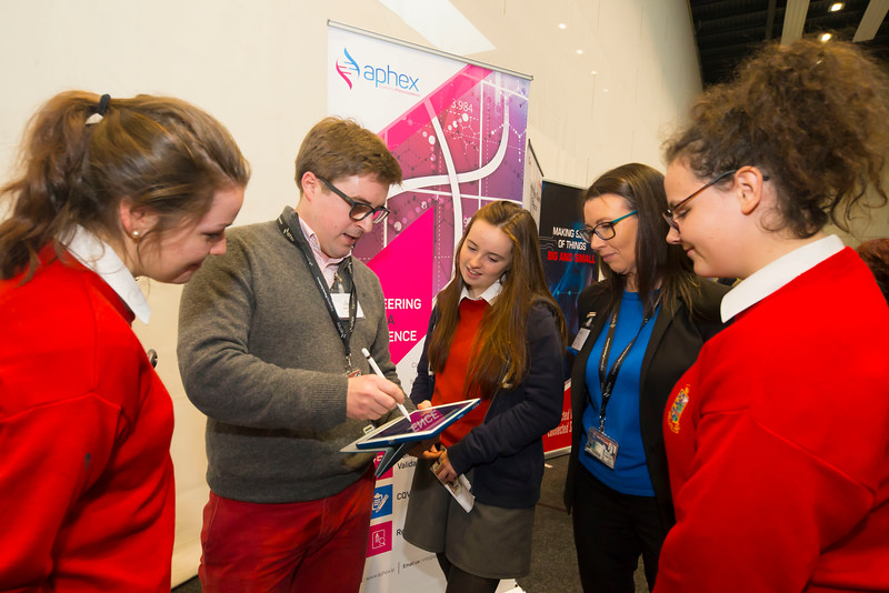 "09/11/2017. Crystal Valley Tech Showcase at WIT Arena. Pictured are Alice Sheridan, Rachel Jacob and Orla Quinn from the Ursuline Secondary School, Waterford City with James Steele and Brenda Duffy from Aphex. Picture: Patrick Browne  Event demonstrates Tech and ICT is thriving in Waterford and the South East 50 companies and 2,000 students, industry and recruiters attend the inaugural Crystal Valley Tech Showcase event  Over 50 companies who are working together as Crystal Valley Tech showcased their rapidly growing industry in the WIT Arena on Thursday morning to approx. 2,000 members of the public, college and second level students, recruiters, government agencies and other industry.  The future is bright for ICT in the South East according to Dr Padraig Kirwan, Head of the Department of Computing & Mathematics at Waterford Institute of Technology. ""Computing is thriving in the South East judging by the number and diversity of ICT companies here today. Even more encouraging is the number of second level students who attended from Waterford, Kilkenny, Carlow, Tipperary and Wexford and how interested they are about the career opportunities in this exciting industry.""  Waterford schools attending the event included the Presentation Secondary School, St Angela's Secondary School, St Paul's Community College, and the Waterford College of Further Education from Water city, St Declan's Community College in Kilmacthomas, and Colaiste Chathail Naofa in Dungarvan.  Elaine Fennelly, Bluefin Payment Systems General Manager and co-founder of Crystal Valley Tech is very excited about the industry in the South East and today's showcase event. ""People who work in the industry already know that Tech is well established in the South East and the number of opportunities and companies continues to grow and grow. According to a recent Tech Ireland report there are over 60 indigenous and multinational companies employing well over 1,500 people from their bases in Waterford"