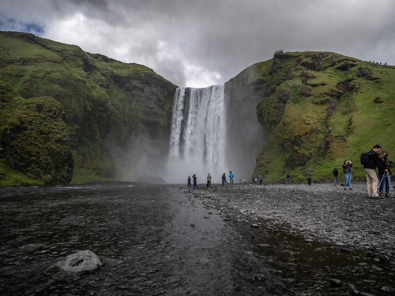 Visitors Enjoying Iceland Waterfall  Photography by Wayne Heim