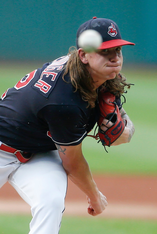 . Cleveland Indians starting pitcher Mike Clevinger delivers against the New York Yankees during the first inning of a baseball game, Saturday, July 14, 2018, in Cleveland. (AP Photo/Ron Schwane)