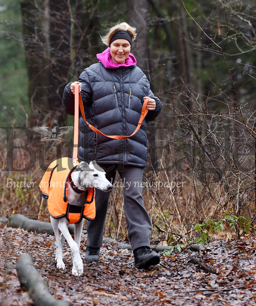 Harold Aughton/Butler Eagle: Anna Marie Stirling of Meridan takes her 8-year-old, rescue greyhound, Auggie for his daily walk at Preston Park, Friday, January 3, 2020.