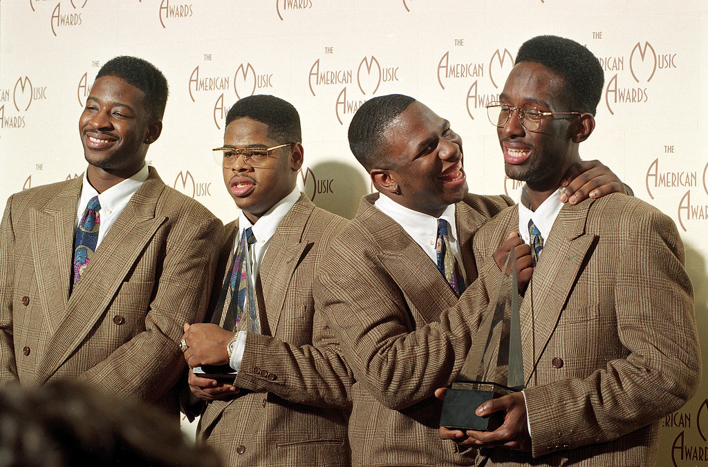 . Boyz II Men members, from left, Mike McCary, Nathan Vanderpool, Wanya Morris and Shawn Stockman, pose for photographers backstage at the 20th annual American Music Awards after winning Favorite Soul-Rhythm and Blues Band and Favorite Pop-Rock Single awards in Los Angeles, Calif., on Jan. 25, 1993. (AP Photo/Reed Saxon)