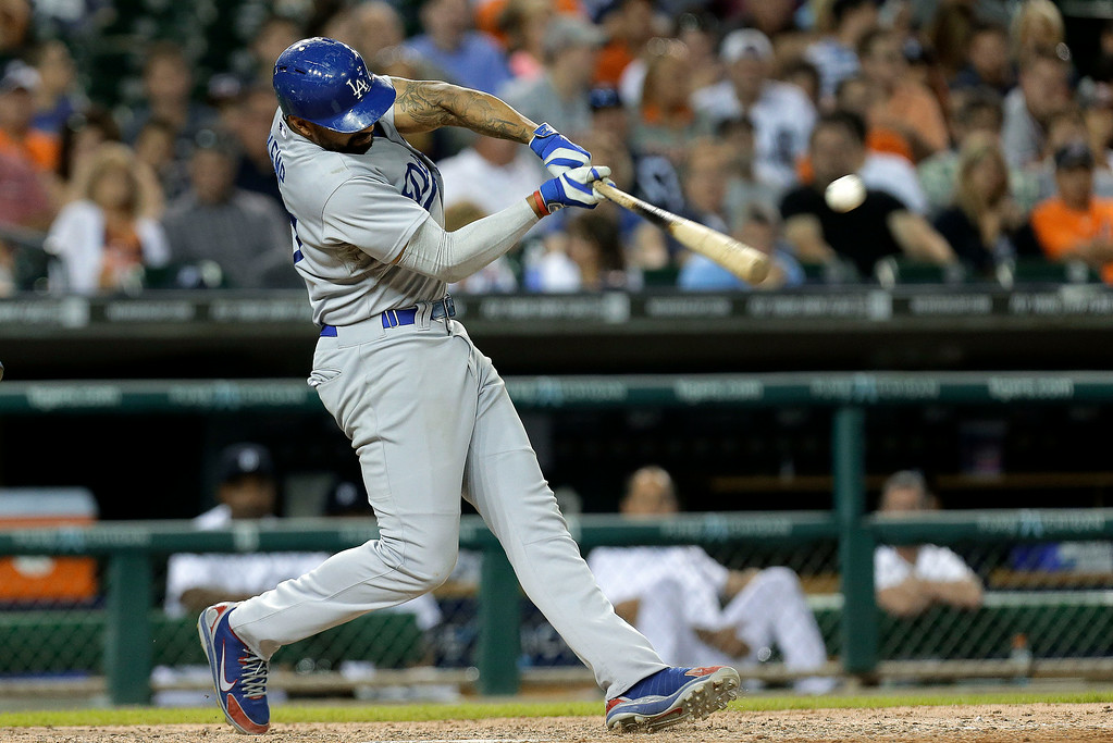 . Los Angeles Dodgers\' Matt Kemp singles against the Detroit Tigers  in the eighth inning of a baseball game in Detroit, Tuesday, July 8, 2014. (AP Photo/Paul Sancya)