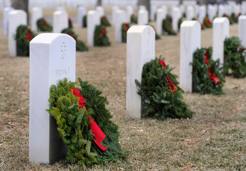 . Ft. Logan National Cemetery hosts its annual Wreaths Across America, a holiday wreath-laying ceremony on Sat. Dec. 15, 2012, that honors and remembers the nations\' veterans. After the ceremony, volunteers and families of loved-ones who are buried here, placed 1,000 wreaths in areas throughout the cemetery. Kathryn Scott Osler, The Denver Post