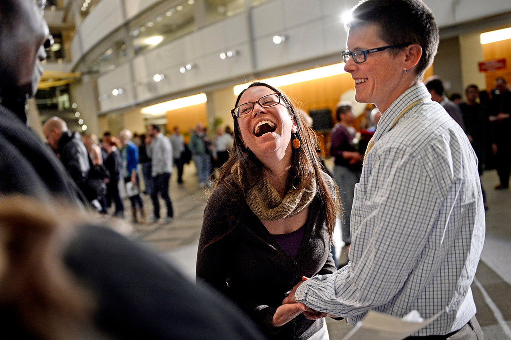 . Colleen Mentz, right, and Jeanne Fischetti share a laugh during their civil-union ceremony, led by Judge Andre Rudolph, in Denver. Couples celebrated their opportunity to hold the first piece of government acknowledgment of their relationships when the Clerk and Record\'s office opened just after midnight April 30, 2013.