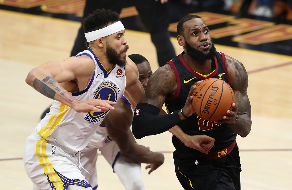 . Cleveland Cavaliers\' LeBron James goes to the basket against Golden State Warriors\' JaVale McGee during the first half of Game 4 of basketball\'s NBA Finals, Friday, June 8, 2018, in Cleveland. (AP Photo/Carlos Osorio)