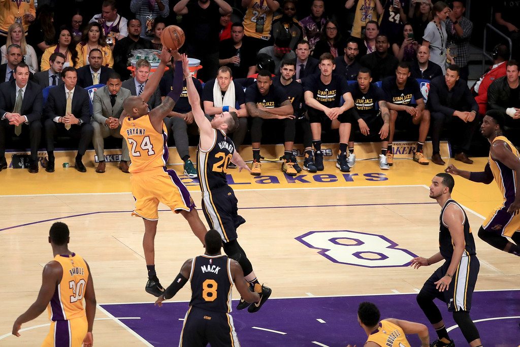. LOS ANGELES, CA - APRIL 13:  Kobe Bryant #24 of the Los Angeles Lakers shoots over Gordon Hayward #20 of the Utah Jazz in the second half at Staples Center on April 13, 2016 in Los Angeles, California. NOTE TO USER: User expressly acknowledges and agrees that, by downloading and or using this photograph, User is consenting to the terms and conditions of the Getty Images License Agreement.  (Photo by Sean M. Haffey/Getty Images)