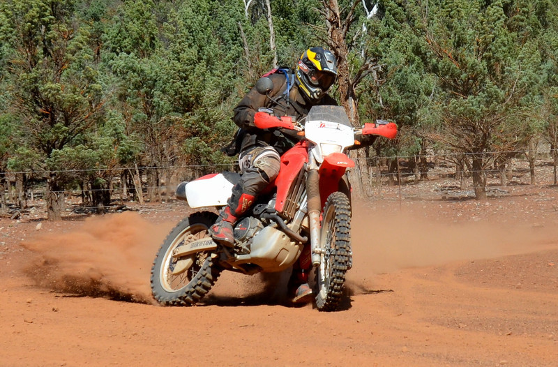 Phil Gill sweeping the track in the Flinders Ranges, SA.