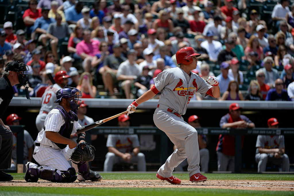 . St. Louis Cardinals starting pitcher Marco Gonzales (56) hits a double to center field off of Colorado Rockies starting pitcher Yohan Flande (58) in the third inning June 25, 2014 at Coors Field. (Photo by John Leyba/The Denver Post)