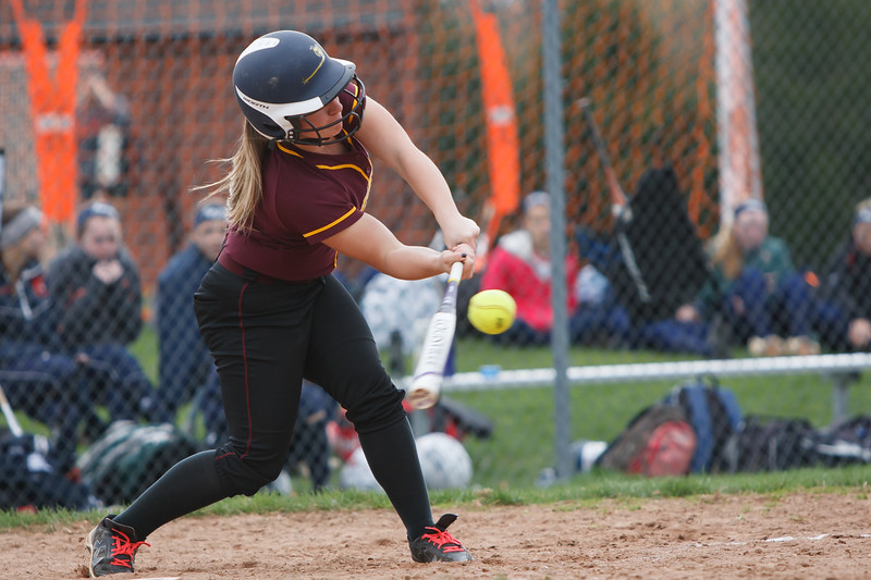 Sheehan's Marissa Vaiana (6)  makes contact Monday at Lyman Hall High School in Wallingford  Apr. 27, 2015 | Justin Weekes / For the Record-Journal
