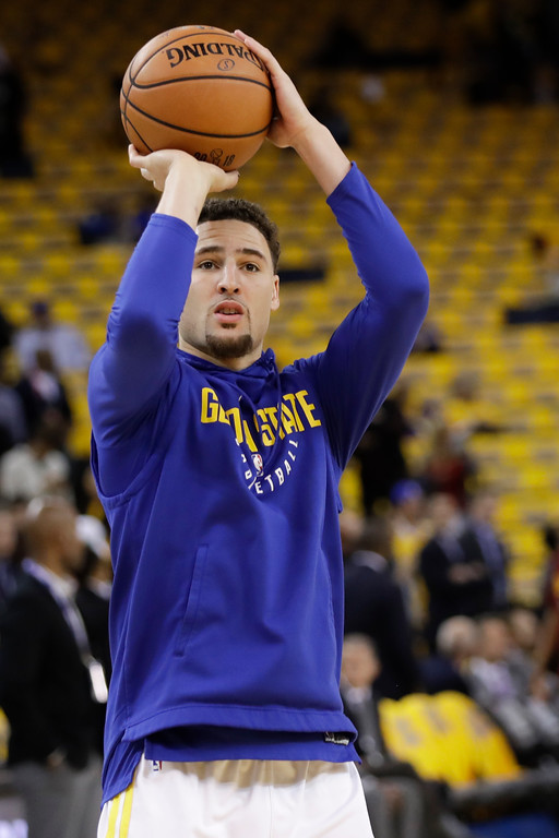 . Golden State Warriors guard Klay Thompson warms up before Game 1 of basketball\'s NBA Finals between the Warriors and the Cleveland Cavaliers in Oakland, Calif., Thursday, May 31, 2018. (AP Photo/Marcio Jose Sanchez)