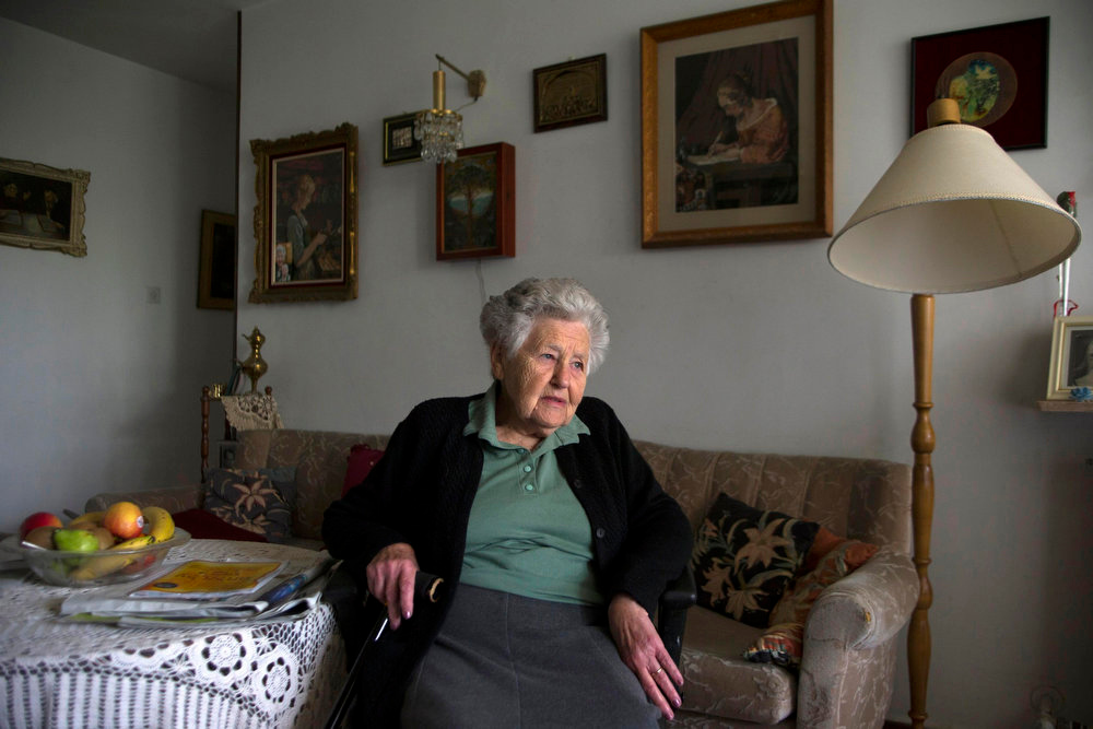 . Hungarian-born Holocaust survivor Miriam Helman, 89, sits in her home in Jerusalem on April 7, 2013. Some 192,000 Holocaust survivors live in Israel and about a third have sought aid from the Foundation for the Benefit of the Holocaust Victims in Israel. According to surveys by the foundation, 19 percent of the survivors have admitted to going without adequate amounts of food and 14 percent had to forego medical treatment at least once a year due to financial hardship. The report said that another severe concern for survivors is loneliness.   REUTERS/Ronen Zvulun