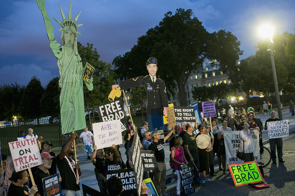 . WASHINGTON, DC - AUGUST 21:  Protesters demonstrate in support of Bradley Manning on August 21, 2013 in front of the White House in Washington, DC. Manning was sentenced to 35 years in prison for leaking hundreds of thousands of classified documents to the anti-secrecy group WikiLeaks.  (Photo by T.J. Kirkpatrick/Getty Images)