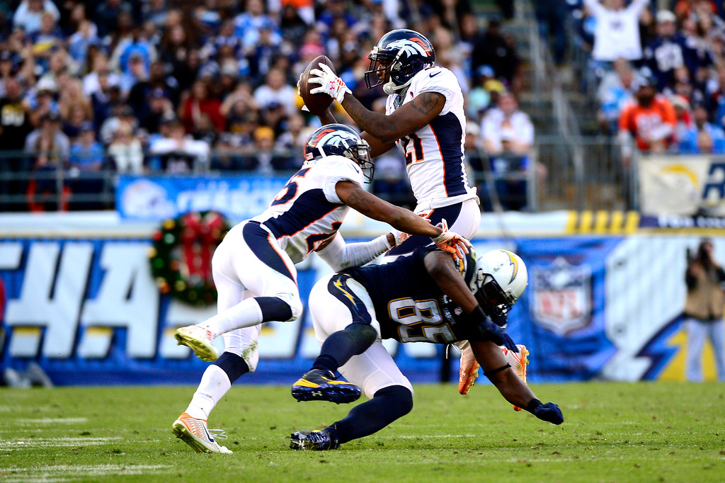 . SAN DIEGO, CA. December 14, - Cornerback Aqib Talib #21 of the Denver Broncos makes an interception in the 2nd half vs the San Diego Chargers at Qualcomm Stadium December 14, 2014 San Diego, CA (Photo By Joe Amon/The Denver Post)