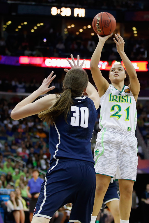 . Kayla McBride #21 of the Notre Dame Fighting Irish makes a shot over Breanna Stewart #30 of the Connecticut Huskies during the National Semifinal game of the 2013 NCAA Division I Women\'s Basketball Championship at the New Orleans Arena on April 7, 2013 in New Orleans, Louisiana.  (Photo by Chris Graythen/Getty Images)