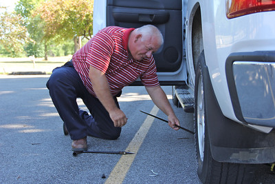 Changing a tire - Roger Larkin