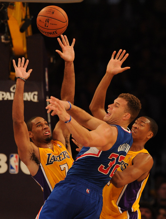 . Clippers#32 Blake Griffin has the ball striped by Lakers#7 Xavier Henry in the 4th quarter. The Los Angeles Lakers defeated the Clippers 116 to 103 in the opening game of the season at Staples Center. Los Angeles, CA. 10/29/2013. photo by (John McCoy/Los Angeles Daily News)