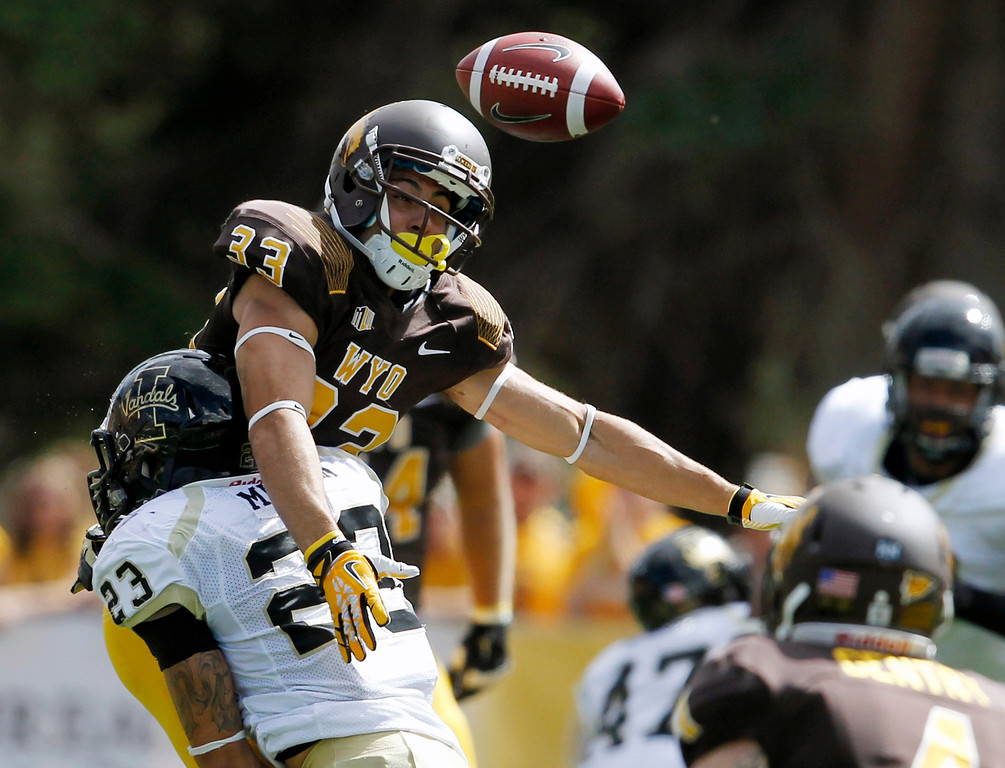 . University of Wyoming receiver Dominic Rufran is hit by University of Idaho defender Mark Millan during the first half of an NCAA college football game at War Memorial Stadium Saturday, Sept. 7, 2013 in Laramie, Wyo. (AP Photo/The Wyoming Tribune Eagle, Michael Smith)