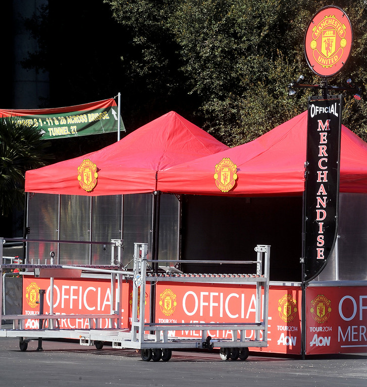 . Official Merchandise booths being set up at the Rose Bowl for the international soccer matchup between LA Galaxy and Manchester United Monday, July 21, 2014. (Photo by Walt Mancini/Pasadena Star-News)