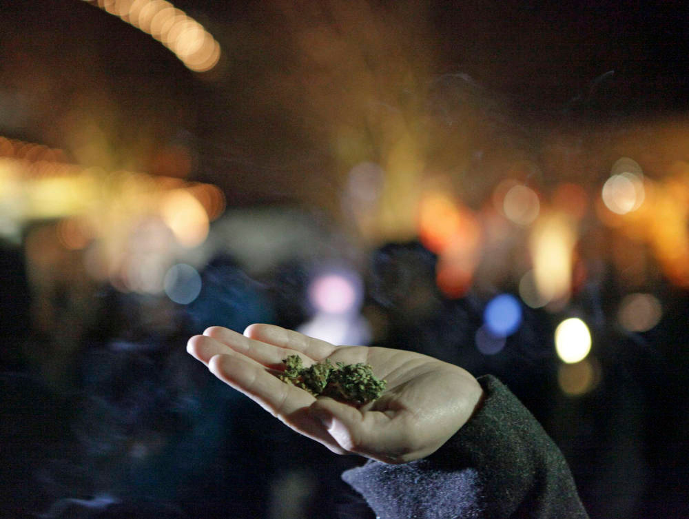 . Marijuana is seen in the hand of a person after the law legalizing the recreational use of marijuana went into effect in Seattle, Washington December 6, 2012. With Washington state the first in the nation legalizing marijuana possession for adult recreational use, Seattle\'s city attorney issued a stern warning on Wednesday to those waiting to celebrate - no pot puffing in public. REUTERS/Cliff Despeaux