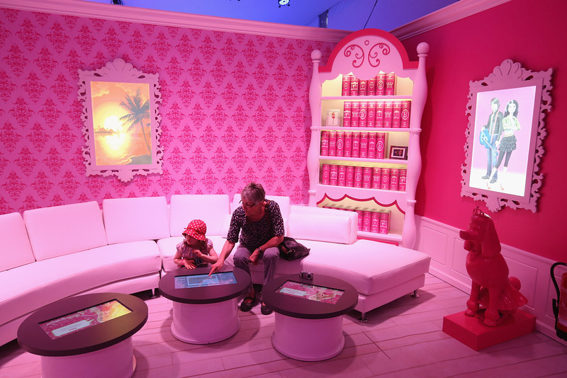 . Karlota, 5, and her grandmother visit the Barbie Dreamhouse Experience on May 16, 2013 in Berlin, Germany. The Barbie Dreamhouse is a life-sized house full of Barbie fashion, furniture and accessories and will be open to the public until August 25 before it moves on to other cities in Europe.  (Photo by Sean Gallup/Getty Images)