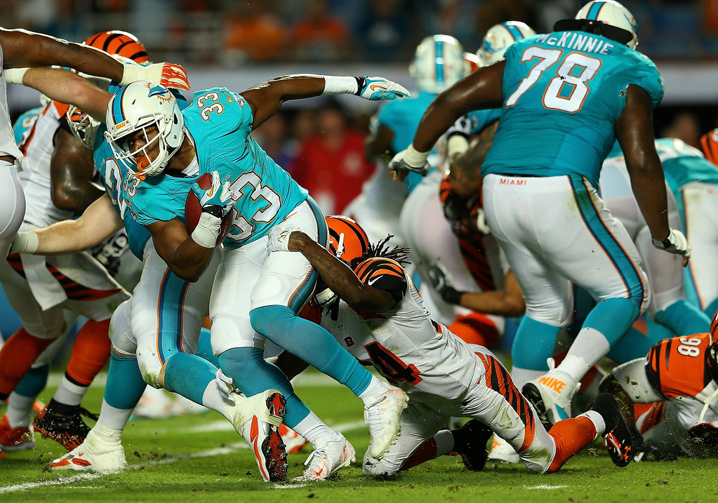 . MIAMI GARDENS, FL - OCTOBER 31: Daniel Thomas #33 of the Miami Dolphins rushes during a game against the Cincinnati Bengals at Sun Life Stadium on October 31, 2013 in Miami Gardens, Florida.  (Photo by Mike Ehrmann/Getty Images)