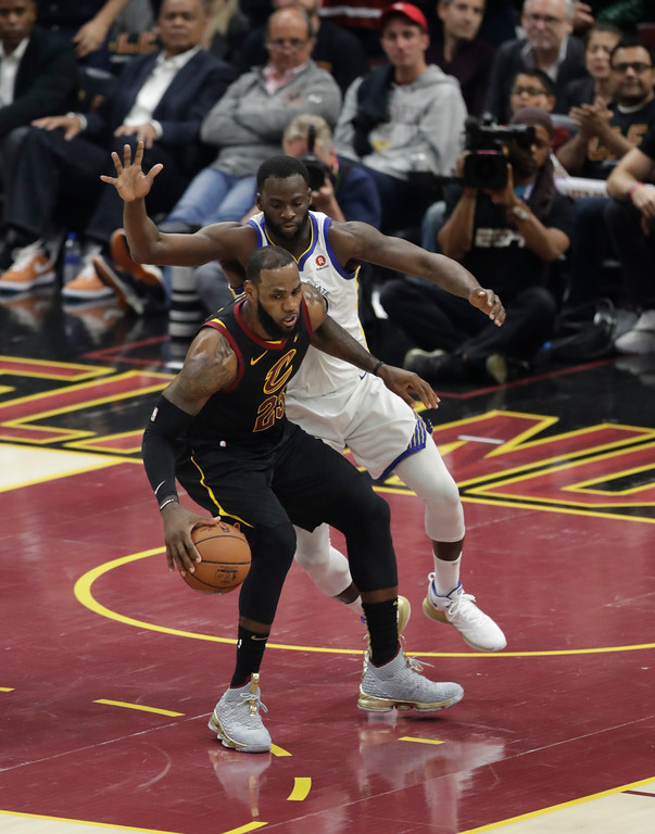. Cleveland Cavaliers\' LeBron James (23) is defended by Golden State Warriors forward Draymond Green (23) in the first half of Game 3 of basketball\'s NBA Finals, Wednesday, June 6, 2018, in Cleveland. (AP Photo/Tony Dejak)