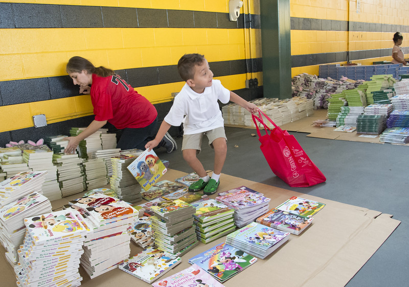 09/04/19  Wesley Bunnell | Staff  Twenty two thousand books were donated to area educators and parents with children by ESPN and Disney on Thursday September 4, 2019 at New Britain Stadium. Noah Morales looks back at his mother for approval on his choice of book to bring home.