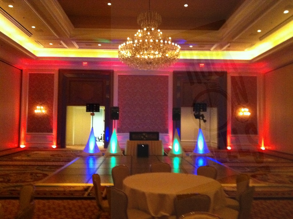 Uplighting on the back wall and dj equipment. This is the middle room at Little America