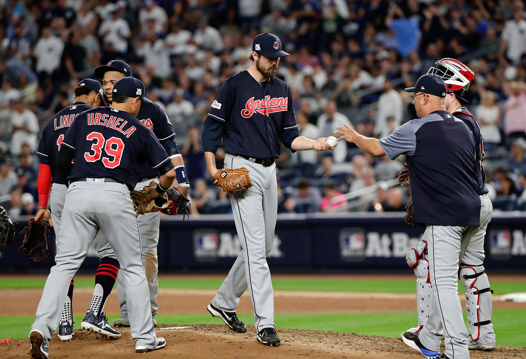 . Cleveland Indians pitcher Andrew Miller, center, hands the ball to manager Terry Francona as he leaves the game during the seventh inning in Game 3 of baseball\'s American League Division Series against the New York Yankees, Sunday, Oct. 8, 2017, in New York. (AP Photo/Frank Franklin II)