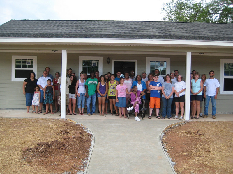 10 07-16 -  House dedication for 25th house built by Chattahoochee Fuller Center.. Partner homeowner is Magby family. Bobbie McBone