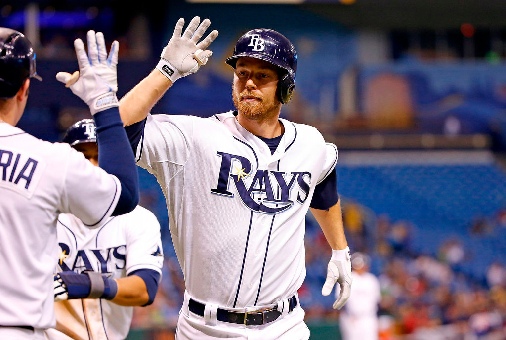 . Infielder Ben Zobrist #18 of the Tampa Bay Rays is congratulated after his seventh inning two run home run against the Minnesota Twins which helped his team beat the Twins 7-4 at Tropicana Field in St. Petersburg, Fla. on Monday, July 8, 2013. (Photo by J. Meric/Getty Images)