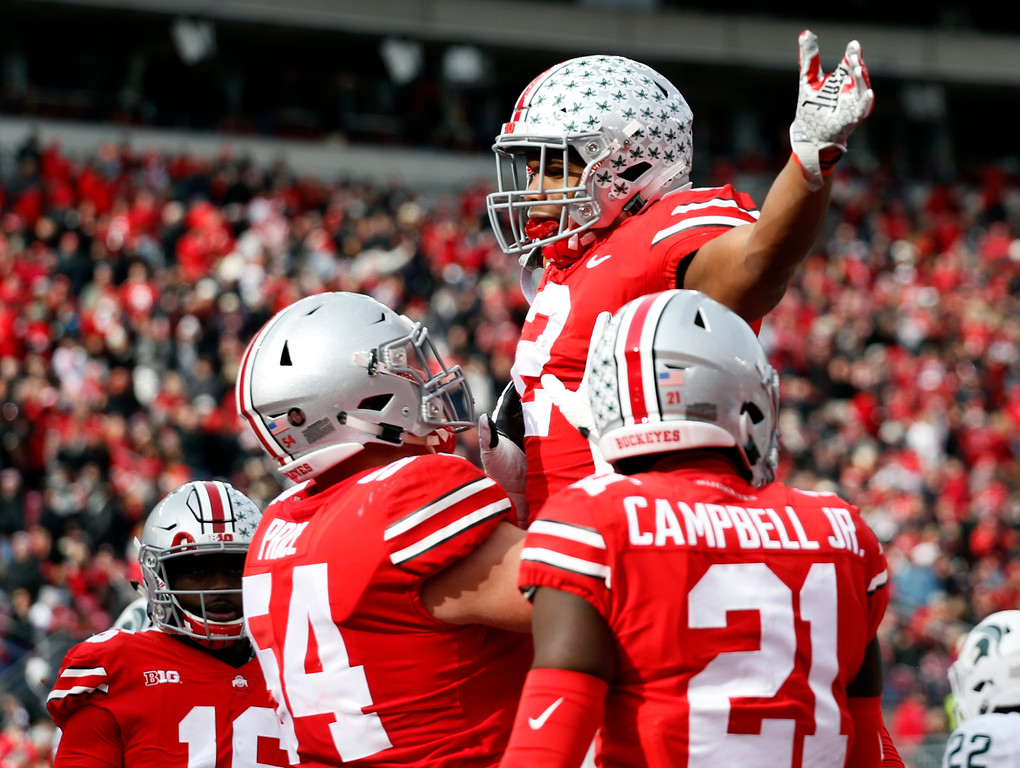 . Ohio State running back J.K. Dobbins celebrates his touchdown against Michigan State during the first half of an NCAA college football game Saturday, Nov. 11, 2017, in Columbus, Ohio. (AP Photo/Jay LaPrete)