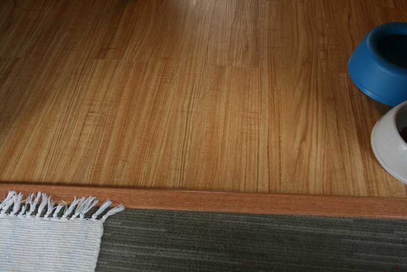 The Flooring project is almost finished. Trafficmaster Allure vinyl flooring in kitchen, hallway and bath. Carpet in living room and bedroom.