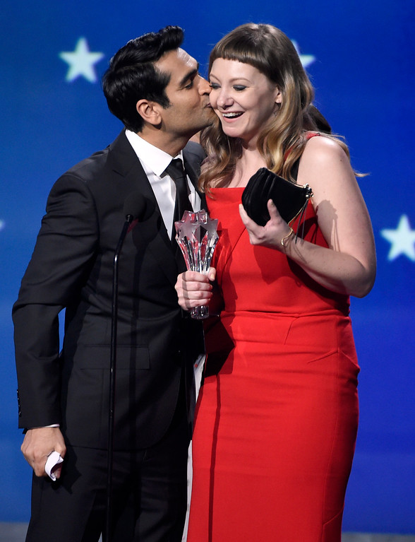 ". Kumail Nanjiani, left, kisses Emily V. Gordon as they accept the award for best comedy for ""The Big Sick\"" at the 23rd annual Critics\' Choice Awards at the Barker Hangar on Thursday, Jan. 11, 2018, in Santa Monica, Calif. (Photo by Chris Pizzello/Invision/AP)"