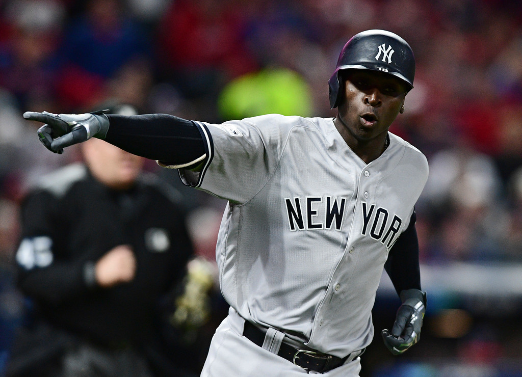 . New York Yankees\' Didi Gregorius points to the dugout after hitting a two-run home run off Cleveland Indians starting pitcher Corey Kluber in the third inning of Game 5 of baseball\'s American League Division Series, Wednesday, Oct. 11, 2017, in Cleveland. Brett Gardner scored on the play. (AP Photo/David Dermer)