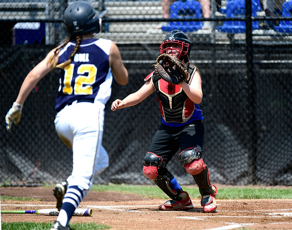 7/25/2019 Mike Orazzi | Staff Connecticut's Madyson Bull (12) and Pennsylvania's Lily Reidy (7) during the Eastern Regional Softball Tournament at Breen Field in Bristol on Thursday.