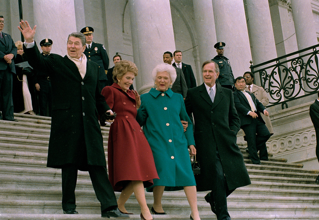 . Former President Ronald Reagan, left, his wife Nancy Reagan, new first lady Barbara Bush and her husband President George Bush, right, walk down the Capitol steps after the inaugural ceremony in Washington, D.C., Friday, Jan. 20, 1989.  President Bush was sworn in as the nation\'s 41st president.  The Reagans are heading to an awaiting helicopter to take them to Andrews Air Force Base, Md., and onto California.  (AP Photo/J. Scott Applewhite)