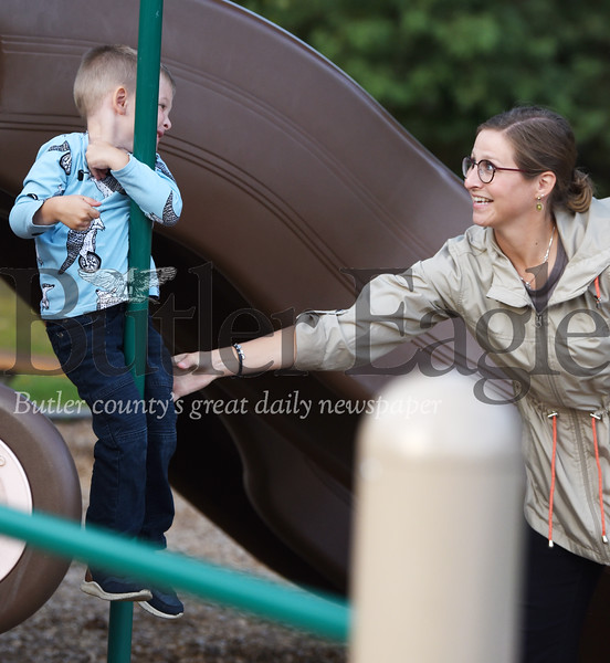 Harold Aughton/Butler Eagle: Nash Randall, 4, of Butler Twp. gets a helping hand from his mother, Susan, at Alameda Park, Tuesday, Sept. 24