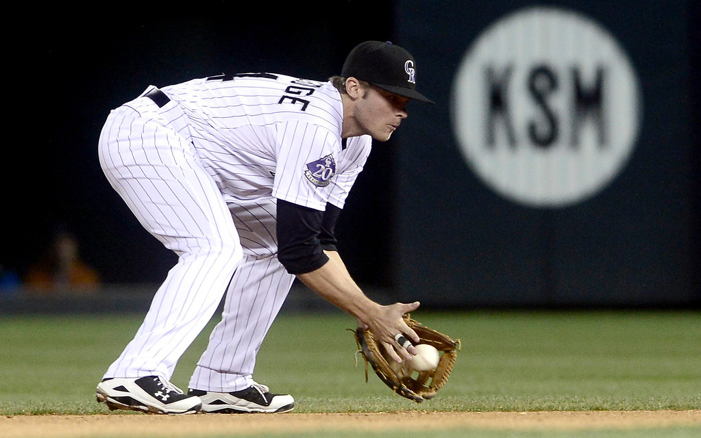 . Colorado Rockies\' second baseman Josh Rutledge stops a grown ball against the New York Yankees\' during their inter-league MLB baseball game in Denver, Colorado May 8, 2013.   REUTERS/Mark Leffingwell
