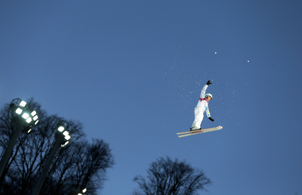 . Kazakstan\'s Zhanbota Aldabergenova jumps during the women\'s freestyle skiing aerials qualifying at the Rosa Khutor Extreme Park, at the 2014 Winter Olympics, Friday, Feb. 14, 2014, in Krasnaya Polyana, Russia. (AP Photo/Andy Wong)