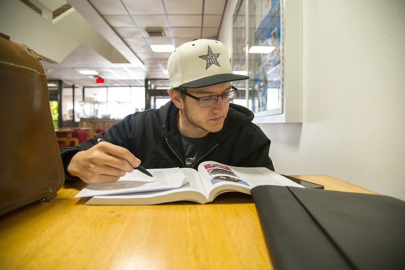 Steven Benedict works on his Geology assignment at the Center for the Sciences.