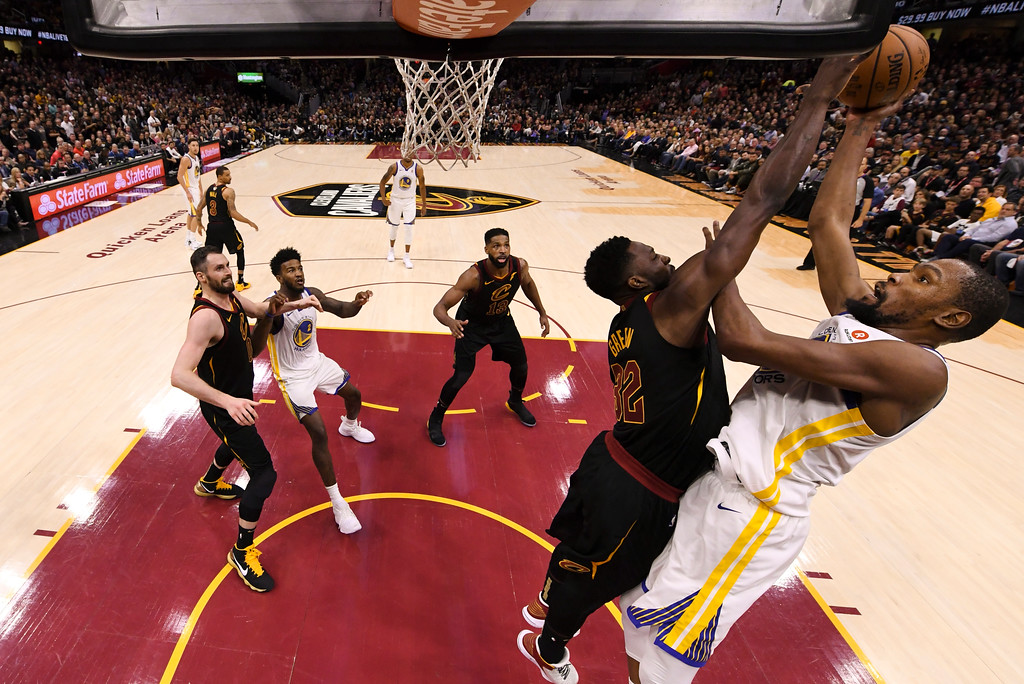 . Golden State Warriors forward Kevin Durant (35) shoots over Cleveland Cavaliers forward Jeff Green (32) during the second half of Game 3 of basketball\'s NBA Finals, Wednesday, June 6, 2018, in Cleveland. The Warriors defeated the Cavaliers 110-102 to take a 3-0 lead in the series. (Kyle Terada/Pool Photo via AP)
