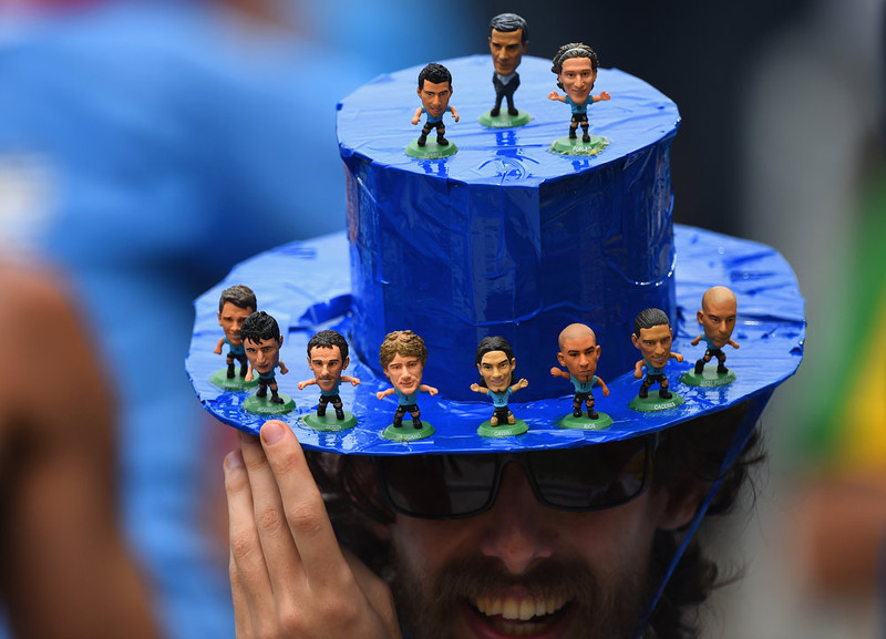 . A Uruguay fan poses with a hat during the 2014 FIFA World Cup Brazil Group D match between Italy and Uruguay at Estadio das Dunas on June 24, 2014 in Natal, Brazil.  (Photo by Matthias Hangst/Getty Images)