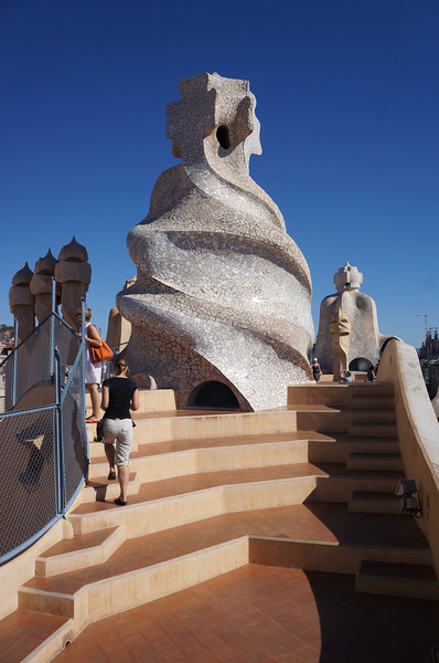 On the roof of Casa Mila (aka La Pedrera). This rooftop is the crowning achievment of an amazing apartment/office complex that Gaudi designed. One could walk for hours up in continual amazement.