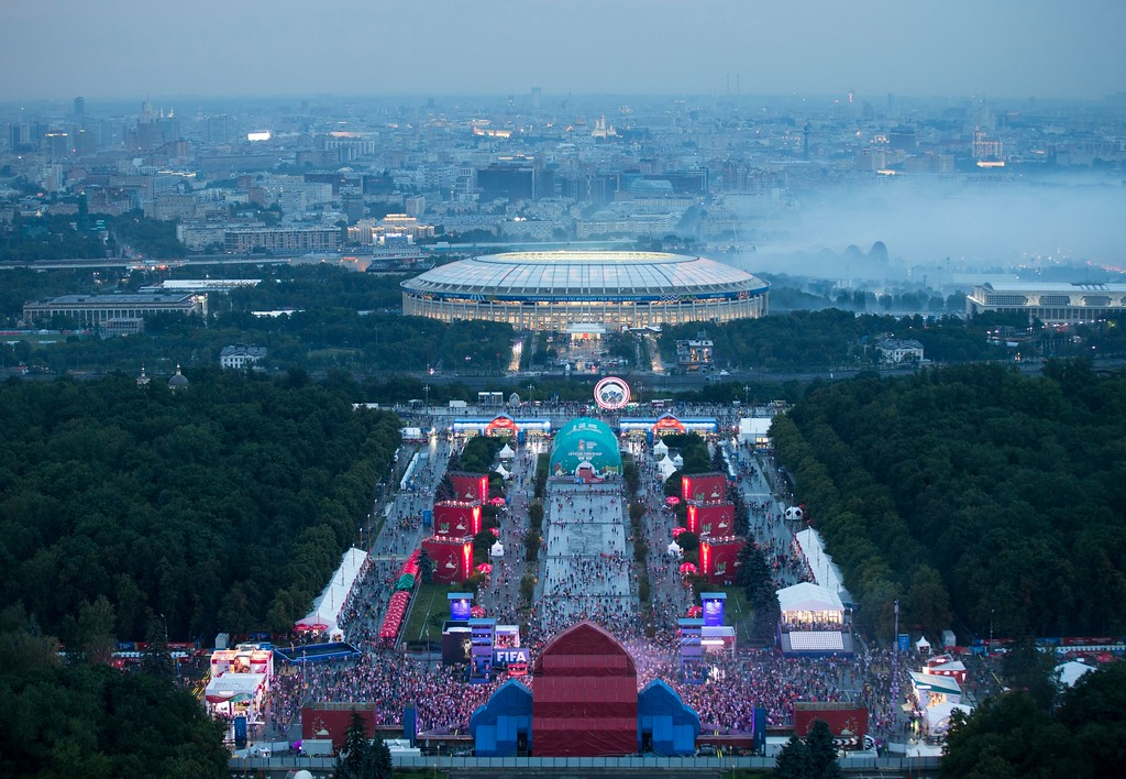 . Soccer fans celebrate in the fan zone near the Luzhniki stadium after the final match between France and Croatia at the 2018 soccer World Cup in Moscow, Russia, Sunday, July 15, 2018. France fans did justice to their team\'s 4-2 victory over Croatia in the World Cup final on Sunday, pouring into Paris\' Champs-Elysees Avenue by the tens of thousands to celebrate with cheers, stomping and song in an explosion of joy mimicked in cities around the nation. (AP Photo/Alexander Zemlianichenko)