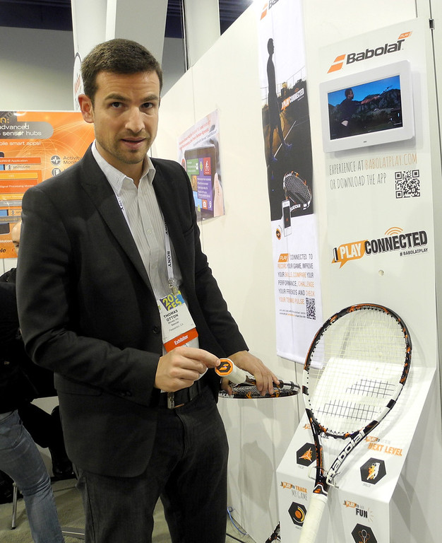". Thomas Otton, global communications director for the French racquet maker Babolat, shows the company\'s connected tennis racquet at the Consumer Electronics Show in Las Vegas on January 10, 2014. ""When you play tennis, you have your own sensation but you don\'t have data on power or where the ball hits,\"" said Otton. Babolat launched its Play Pure Drive racquet in the US in December and will release it worldwide later this year. \""There is also a gamification aspect to this. With the app, you can compare your performance to that of your friends, even to Rafael Nadal.\"" (Rob Lever/AFP/Getty Images"