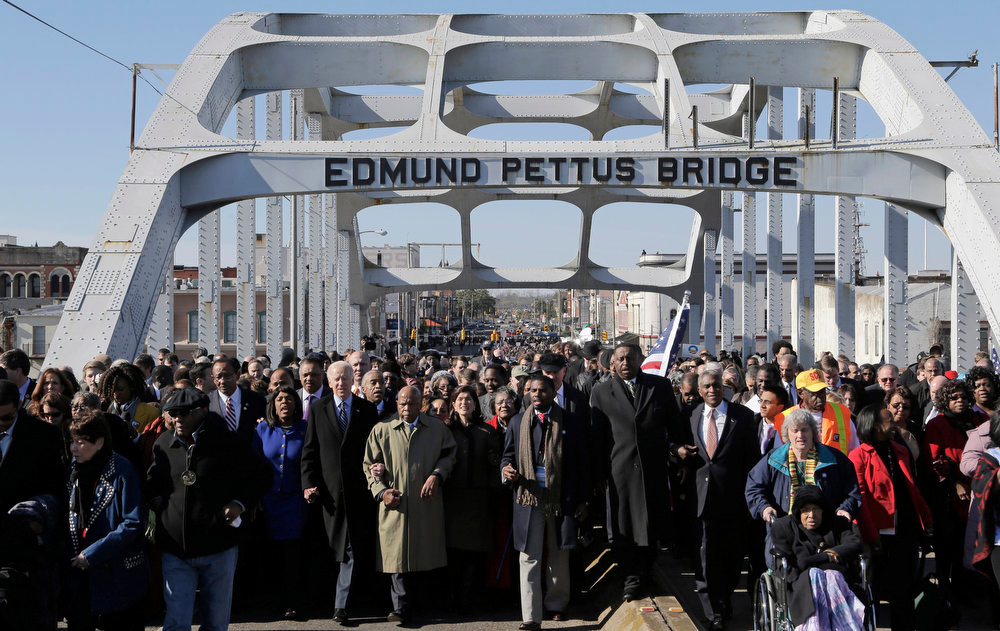 . Vice President Joe Biden and U.S. Rep. John Lewis, D-Ga., lead a group across the Edmund Pettus Bridge in Selma, Ala., Sunday, March 3, 2013. They were commemorating the 48th anniversary of Bloody Sunday, when police officers beat marchers when they crossed the bridge on a march from Selma to Montgomery.  (AP Photo/Dave Martin)