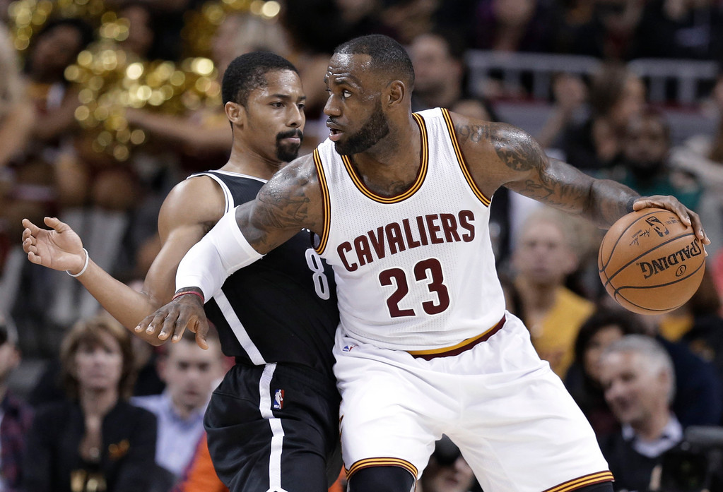 . Cleveland Cavaliers\' LeBron James (23) drives past Brooklyn Nets\' Spencer Dinwiddie (8) duirng the first half of an NBA basketball game, Friday, Jan. 27, 2017, in Cleveland. (AP Photo/Tony Dejak)
